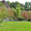 Bambuszaun mit Edelsstahl als Sichtschutz im Garten